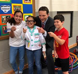Travis Herzog visits with Anderson students