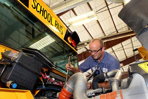 Jesse Bankston, Spring ISD transportation shop supervisor, makes sure a school bus is road-ready