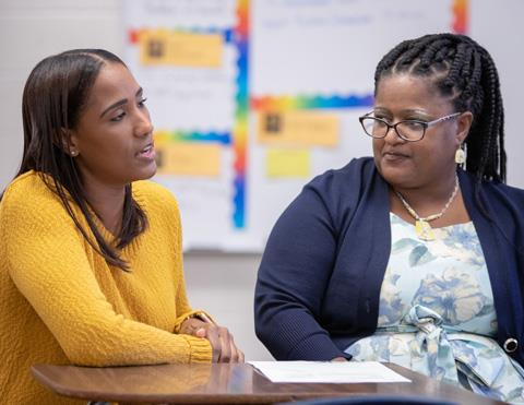 Twin Creeks Middle School parent Sonaida Lara, from left, discusses her son's Individualized Education Program (IEP) with special education teacher Latrina Montgomery
