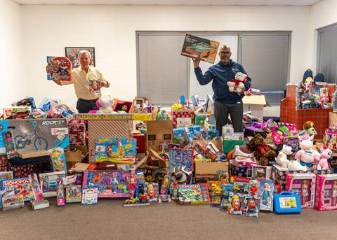 NAM President and CEO Les Cave and Spring ISD Superintendent Dr. Rodney Watson display toys donated by the Spring community