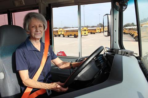 Spring ISD bus driver, Andrea Crafton, prepares to pull out of the transportation bus lot
