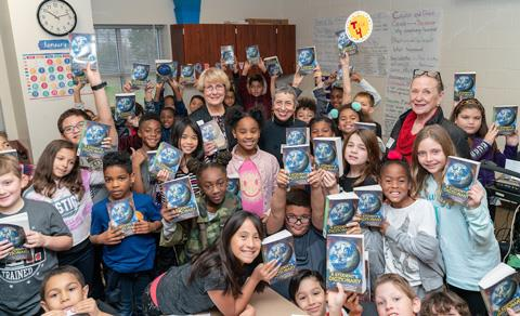 The Dictionary Project founder and executive director Mary French poses with volunteers Sue Kikis, Sue Lurcott and third-graders at Northgate Crossing Elementary School