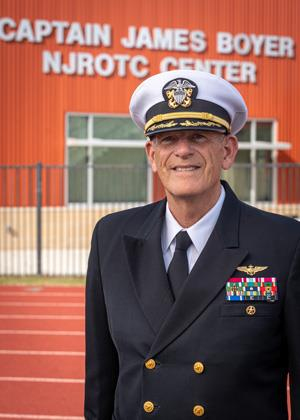 Retired U.S. Navy Capt. James Boyer, lead instructor of Spring High School's Navy JROTC program for almost two decades, stands in front of the new facility that bears his name