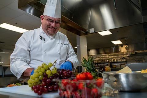 Spring ISD Chef Gerry UpdeGraff prepares ingredients while testing a new recipe in the kitchen at the district's Child Nutrition and Training Center