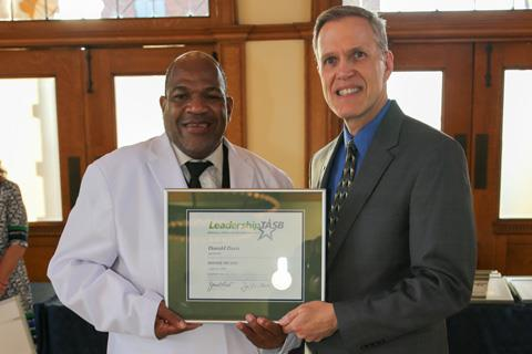 Spring ISD Trustee Donald Davis, from left, is pictured with TASB Division Director of Leadership Team Services Phil Gore