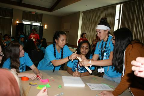 Spring ISD middle school girls build a project at the ExxonMobil Girls Engineering Festival
