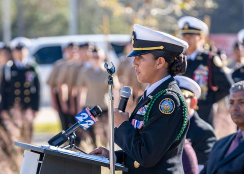 Spring High School senior and Navy JROTC Executive Officer Lilian Dehoyos addresses attendees during the dedication ceremony of the Veterans Memorial at Spring ISD's Planet Ford Stadium in December