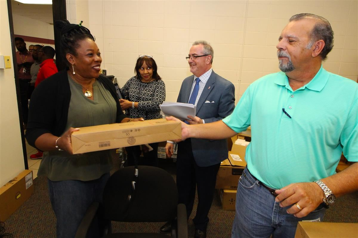 Roberson teacher Jennifer Ogunsanya receives her new laptop.