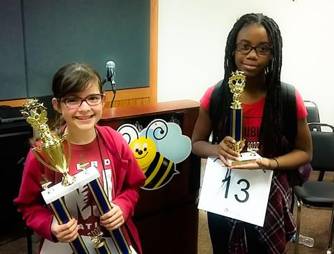 Spring ISD Spelling Bee champion Lucille Rixner, a sixth grader at Roberson Middle School, from left, displays her first-place trophy along with Bethany Johnson, an eighth grader from Bammel Middle School, who is the alternate champion